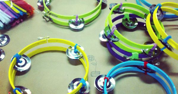 Handmade tambourines from painted embroidery hoops and pipe cleaners. Love this idea!