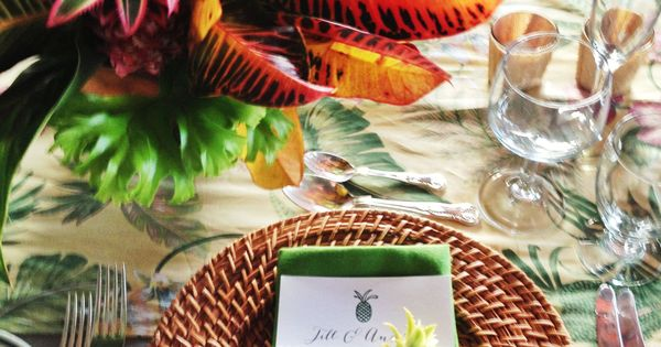 Centerpieces of tropical foliage in fun colors. We could alternate the tables