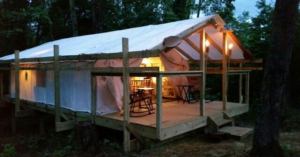 Canvas Wall Tent Built On Platform With Hitching Rails
