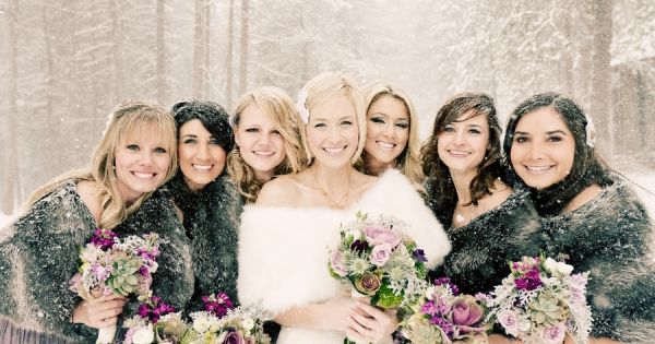 Outdoor Bridal party photo. Note the two girls behind closes to the