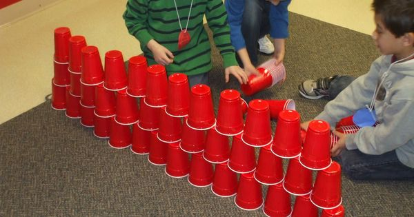 cup stacking with 100 cups on the 100th day of school- works