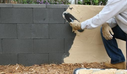 Stucco Applied To Retaining Wall An Idea For Those Who Have A Walk Out Basement With Block Retaining Concrete Block Walls Cinder Block Walls Concrete Blocks