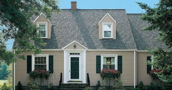 Beige Siding With Deep Blue Shutters M Matching Door And Dark Stone House Exterior House Paint Exterior Shutters Exterior