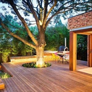 Highly Beautiful Backyard Wooden Deck Around A Tree Design Ideas