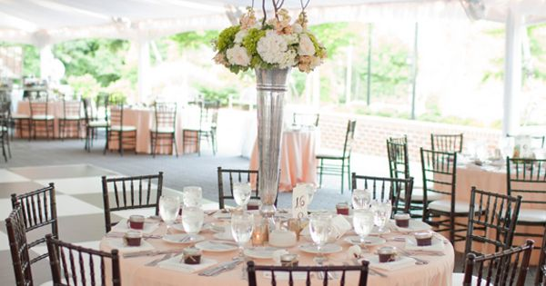 tall centerpiece with peach linens | Kellie Kano