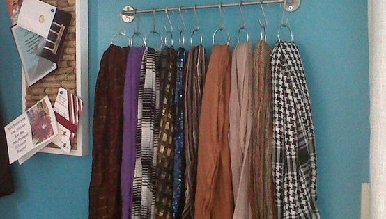 A towel bar with shower curtain hooks = scarf organizer! Could also