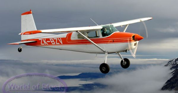 Stock Photo Titled Small Cessna Airplane In Sunlight Against Dark