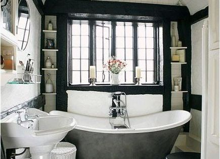 Black wall, bathtub on legs