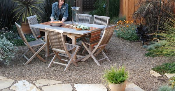 Choose natural stone and pea gravel for a low-key look. If you