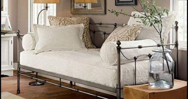 Cute Iron Daybed Two Rolled Pillows On Either End Third