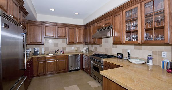 this spacious kitchen features high end stainless steel