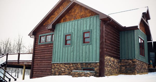 Exterior board and batten in a green stain color rustic for Log cabin exterior stain colors