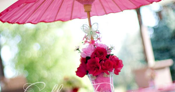 I love these parasol centerpieces! The bright color makes a bold statement