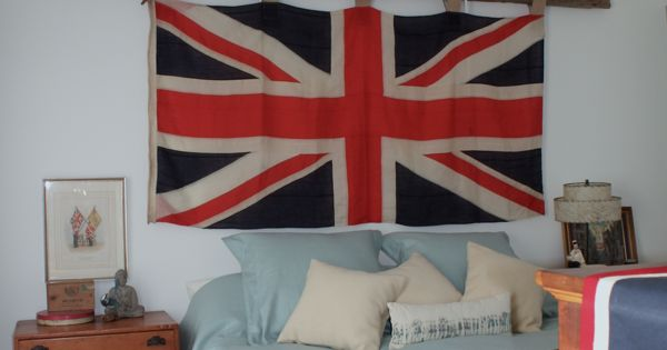 Rustic bedroom ideas union jack flag hung by an antique for Union jack bedroom ideas