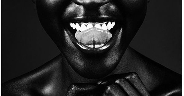 Alek Wek / laughing - I think she is so flawless, and