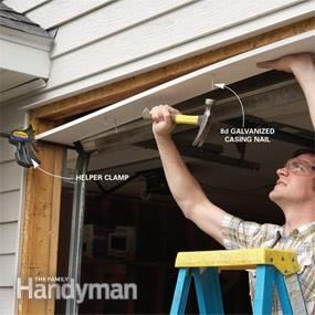 Fixing Garage Door Bottom Seal The Family Handyman Garage Door Trim Garage Door Framing Garage Door Weather Stripping