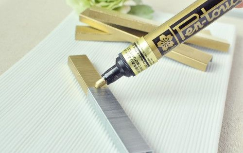 Grab a permanent marker! A paint pen can change your staples for
