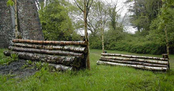 Mobile cross country jumps include log pile walls kennels for Country cottage kennel