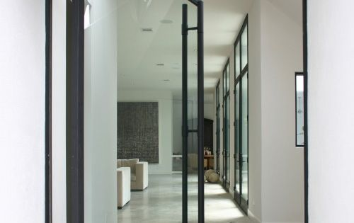 dramatic pivot door entry in Sunset Boulevard House from Allen Bianchi Architects.
