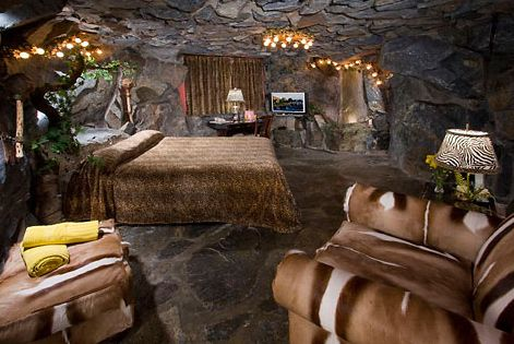Madonna Inn S Caveman Room A Whimsical Glimpse Into His Existence Is Revealed In This Rustic Den Of Solid Madonna Inn Rooms Themed Hotel Rooms Unusual Hotels