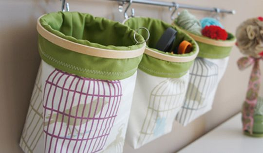 Great toy storage idea: embroidery hoops and pillowcases...cute storage idea (Legos, blocks,