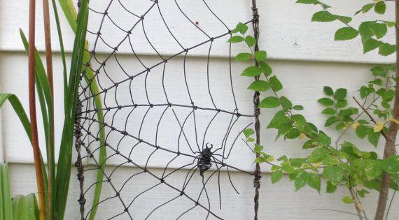 Spider spinning a web barbed wire garden trellis made to order for Trellis made to order