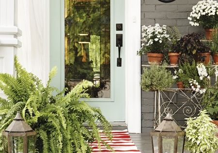 Update you front door color, add creative house numbers and add greenery