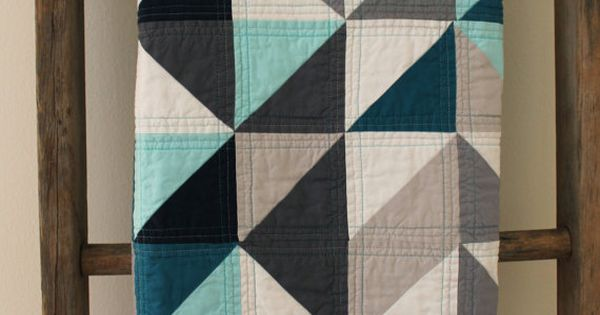 grey and blue geometric quilt -- I love the machine quilting pattern