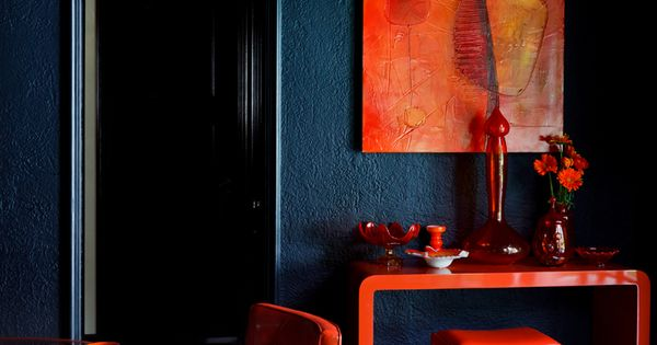 ? Contemporary interior design with bold orange and dark hotel interior design