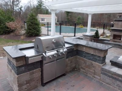 Backyard Bar And Grill Ideas 22 outdoor kitchen design ideas Outdoor Kitchen With Granite Counter Tops And Built In Grill Overlook A Pool And Outdoor Fireplace With Pergola On Paver Patio By Bahler Brothers