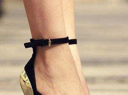 Black and Gold Sandals. If anybody knows the designer, please let me