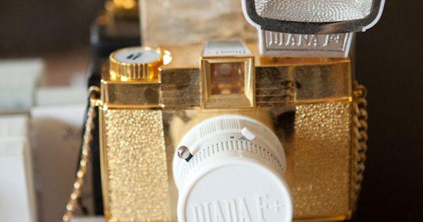 old school metallic gold camera.