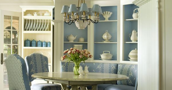Cabinets provide room divider for beautiful dining area for Light blue dining room ideas