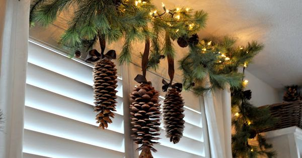 Greenery Pinecones And Mini Lights For An Above The