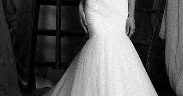 black and white photo of a simple mermaid wedding dress. My dream