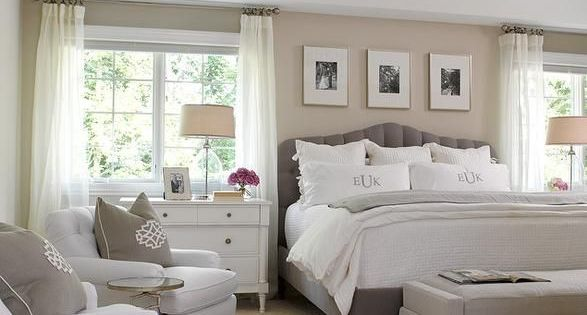 Chic Bedroom Features A Sand Colored Accent Wall Lined