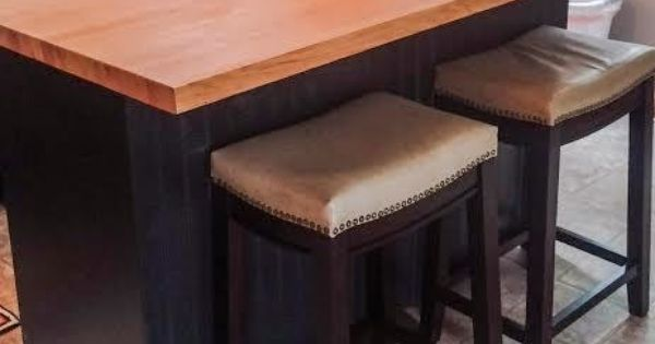 Diy kitchen island with bar seating from an old dresser for Building a kitchen island with seating