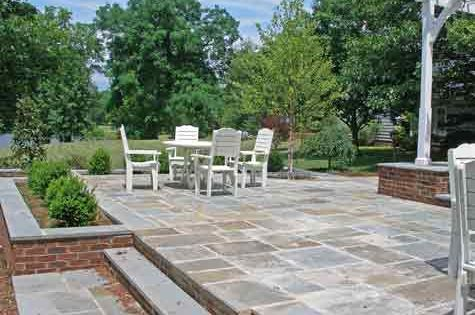 find out what a two level bluestone patio costs and how you can cut down but - Raised Patio Ideas