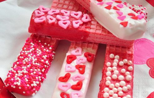 valentine cookies - strawberry sugar wafers dipped in white chocolate or colored