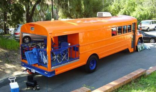 Bus camper with a porch. What a great idea for camping or