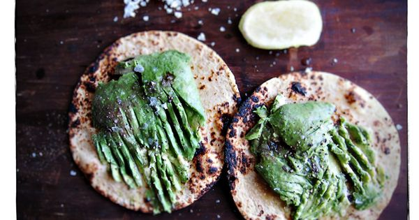 Toasted corn tortillas toasted with mashed avocado, lime and sea salt. Yum!