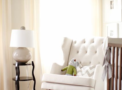 A rocking wingback chair. Baby room.