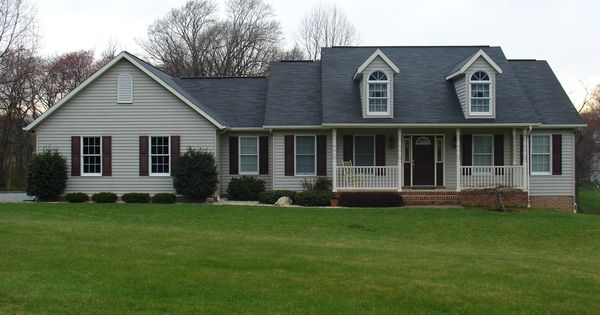 Front view custom rancher with two dormers to look like a for Vinyl siding that looks like brick
