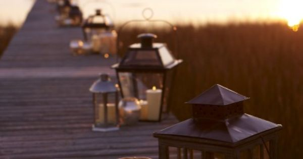 Lanterns from Pottery Barn running down the dock. Love