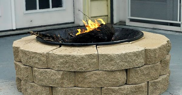 DIY firepit for $30...This is such a good idea! Use old fire
