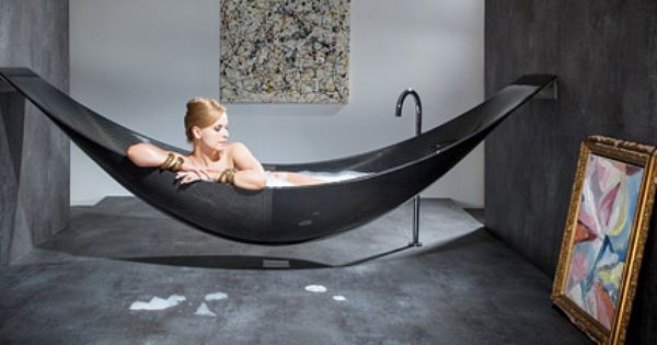 Hammock shaped bathtub designed by splinter works is made for Carbon fiber hammock bathtub