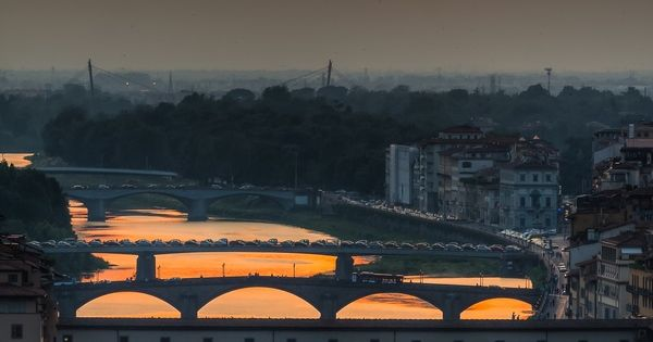 Sunset on Ponte Vecchio and bridges of the River Arno in Florence,