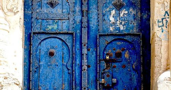 Yemen doors. I love the design of the creamy colored archway in