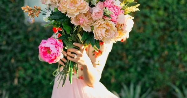 A gorgeous photo shoot featuring a hot pink bike, a pink gauzy dress and beautiful peonies at The Sweetest Occasion