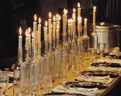 Table setting with wine bottle candle holders.